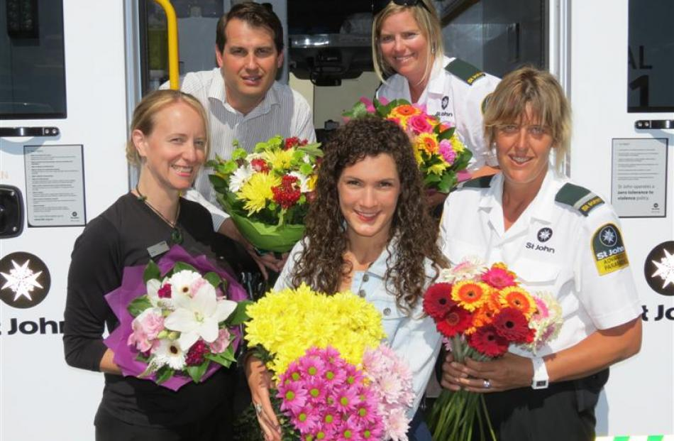 St Valentine's Day bouquet deliverers (from left) ASB senior customer service supervisor Jillian...