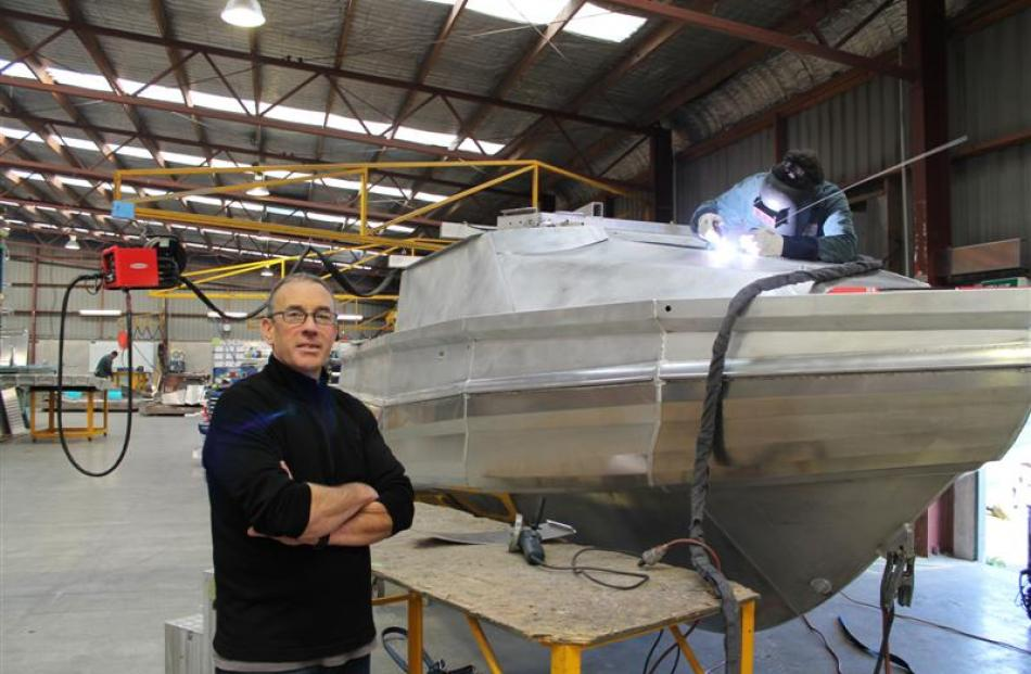 Stabicraft Marine managing director Paul Adams, in the company's Invercargill factory, as boat...