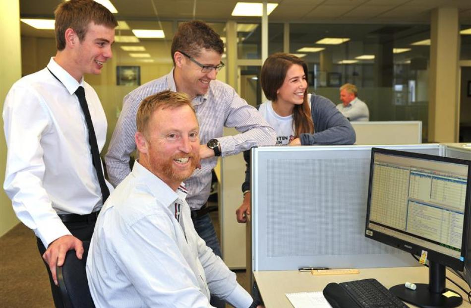 Staff at Craigs Investment Partners brokerage, (front) broker Peter McIntyre, (back, from left)...