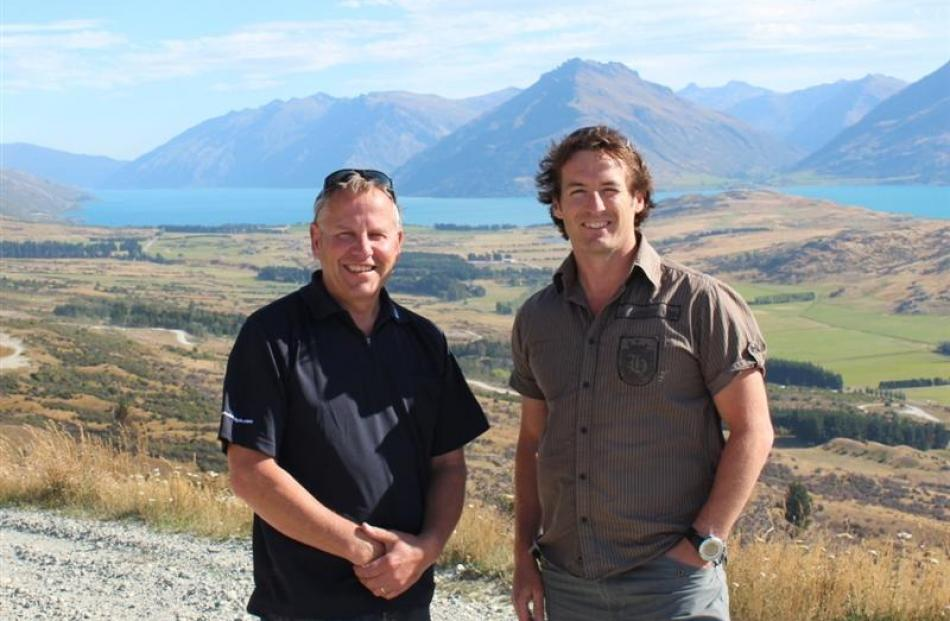 Standing at the 4km mark of the Remarkables skifield access road are ski area manager Ross...