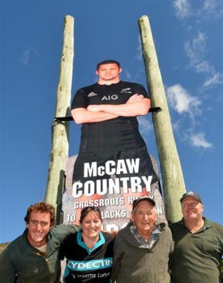 Standing beneath the billboard of  Waitaki Valley hero Richie McCaw in Kurow are (from left)...