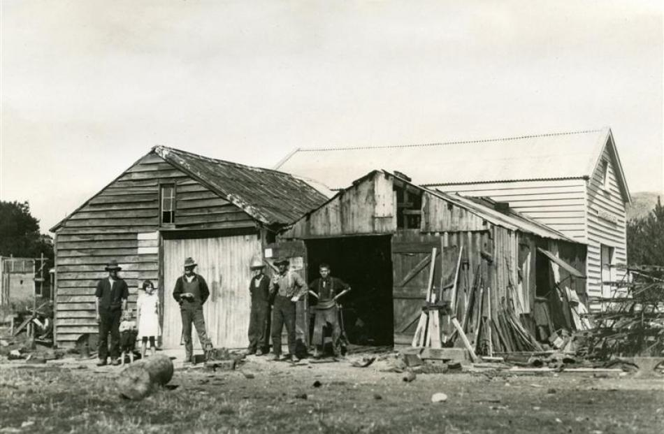 Standing outside the workshop in 1933-34, at the site from where the company still operates, are ...