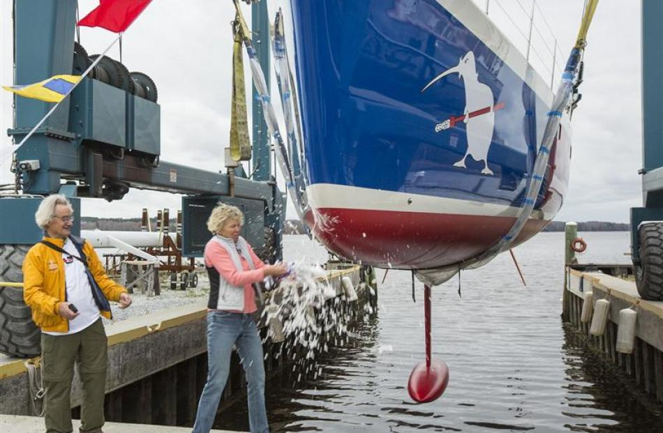 Stanley Paris  watches as  Heidi Lyman smashes a Champagne bottle over the bow of his yacht Kiwi...