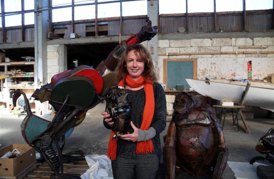Steampunk HQ co-ordinator Jan Kennedy prepares for the opening on Friday of ''Recycled Relics'',...