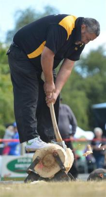 Steve Unahi, of Winton, competes in the wood chopping exhibition. Photos by Peter McIntosh.