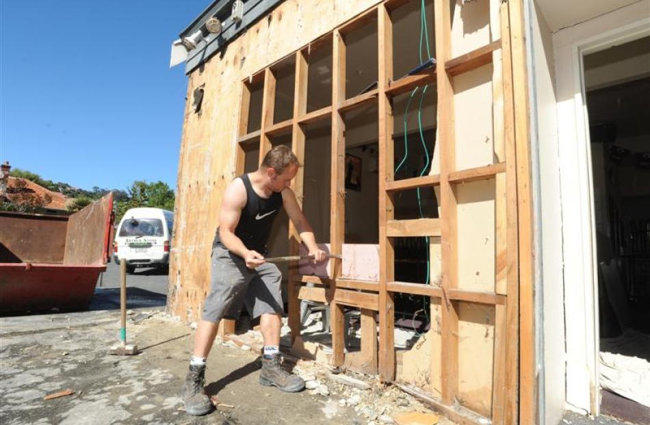 Steven Crosbie, of Arthur Stone Builders, repairs a damaged wall at Mitchell's Tavern in...