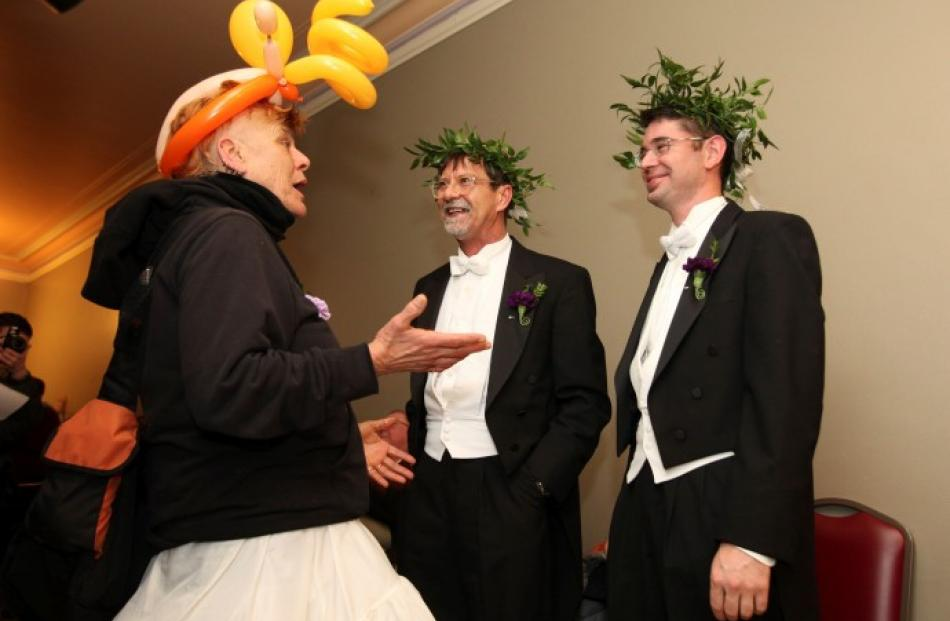 Steven Jones (C) and Jamous Lizzotte speak with Gabe Morte as they wait to receive marriage...