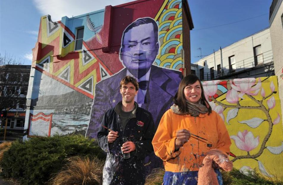 Stickum Co-operative artists Guy Howard-Smith and Aroha Novak finish painting a mural in Rattray...