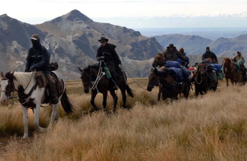 Strong winds chill riders on the Speight's packhorse traverse as they near the summit of Mt...