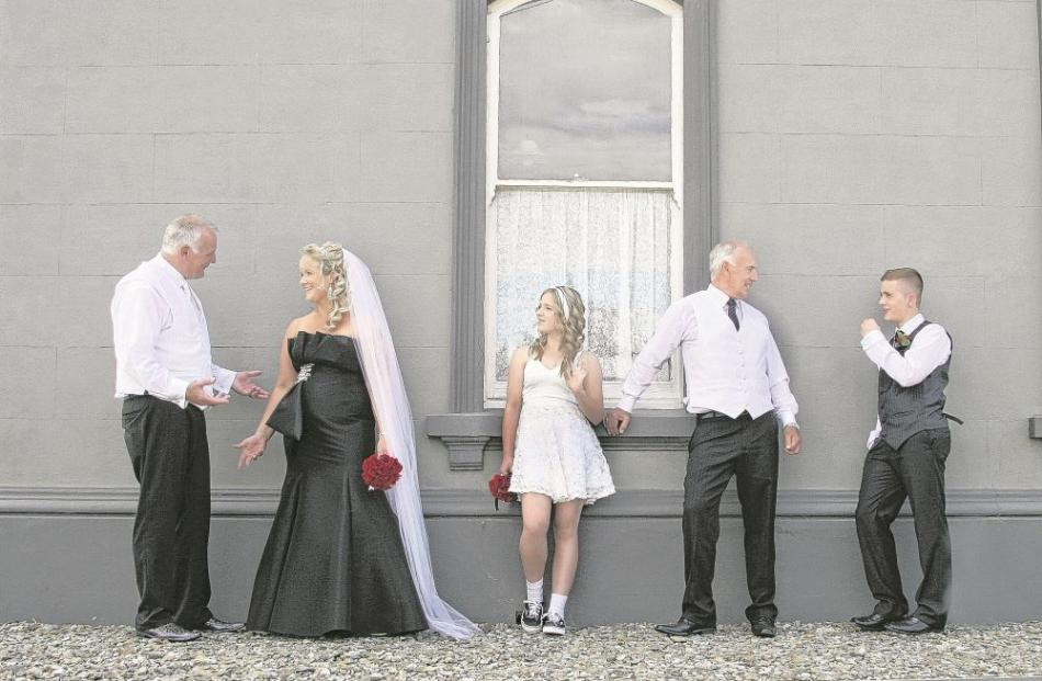 Stuart Ellwood and Angela Walton with their attendants at their Outram wedding in February.