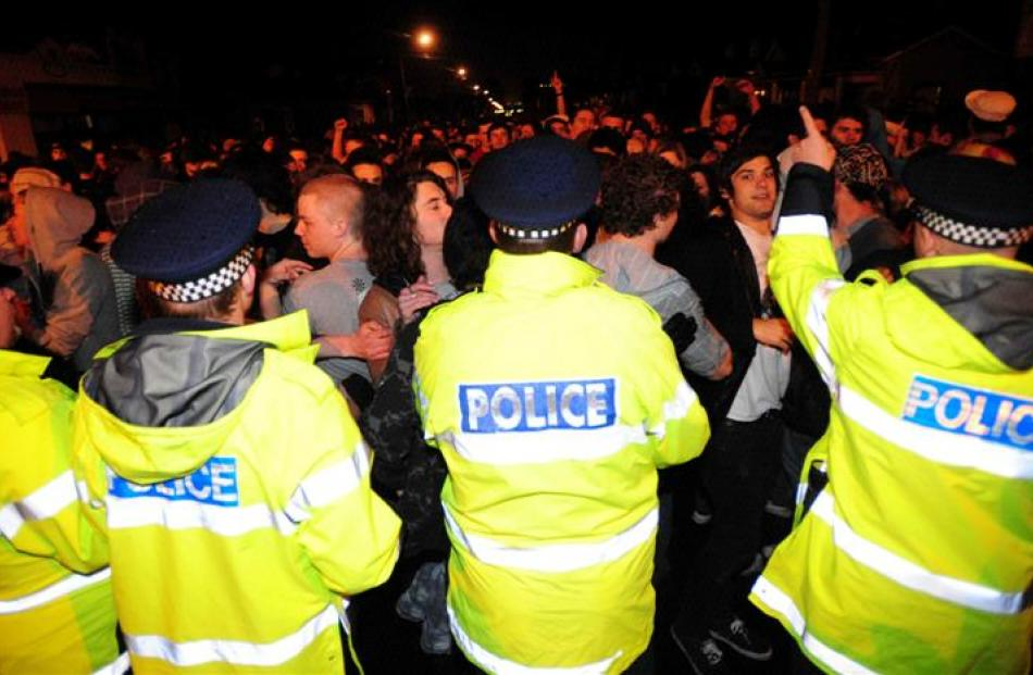 Police and students face off on Castle St. Photo by Craig Baxter