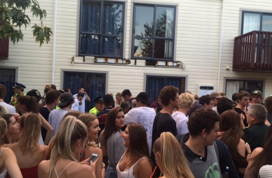 Students at Castle St beneath where the balcony fell. Photo: Rhys Chamberlain