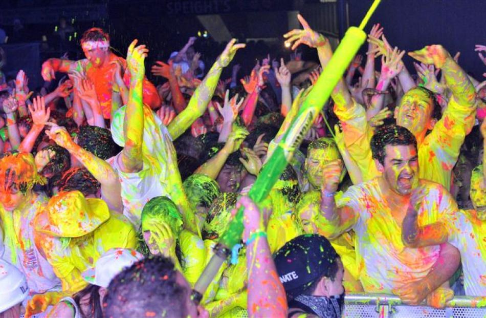Students enjoy last Thursday's Illuminate paint party at Forsyth Barr Stadium. Photo by Linda...