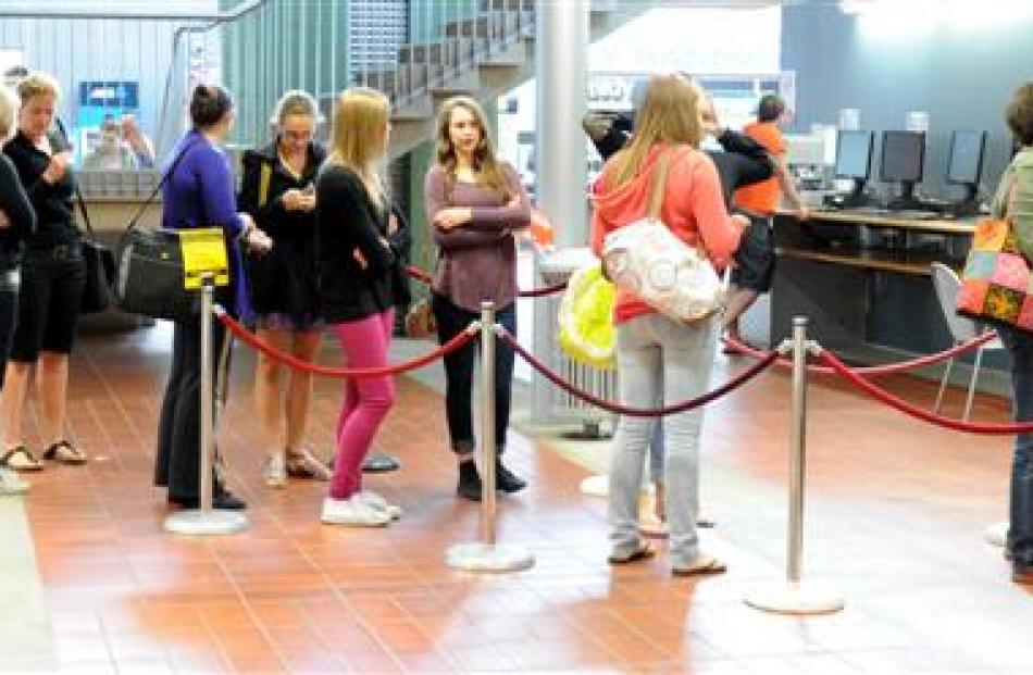 Students line up for identification cards at the University of Otago's  summer school. Photo by...