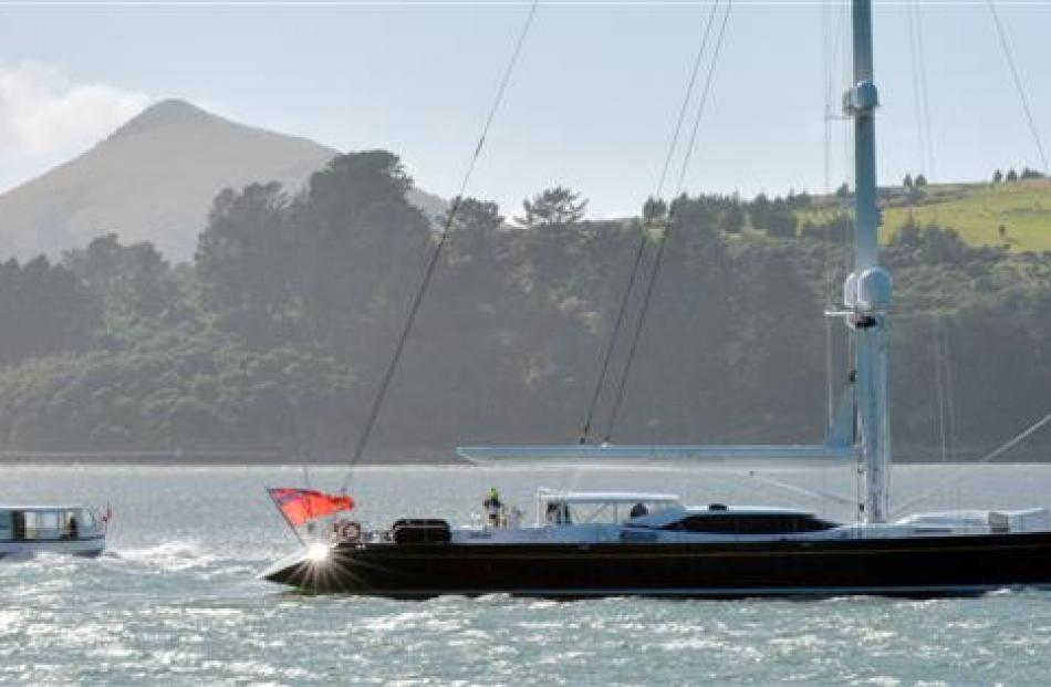 Super yacht Janice of Wyoming passes  Monarch on its way up Otago Harbour to Dunedin yesterday...