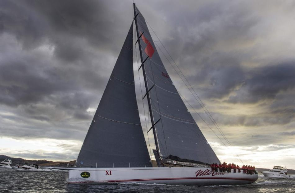 Supermaxi yacht Wild Oats XI competes to win the annual Sydney to Hobart yacht race in Hobart....