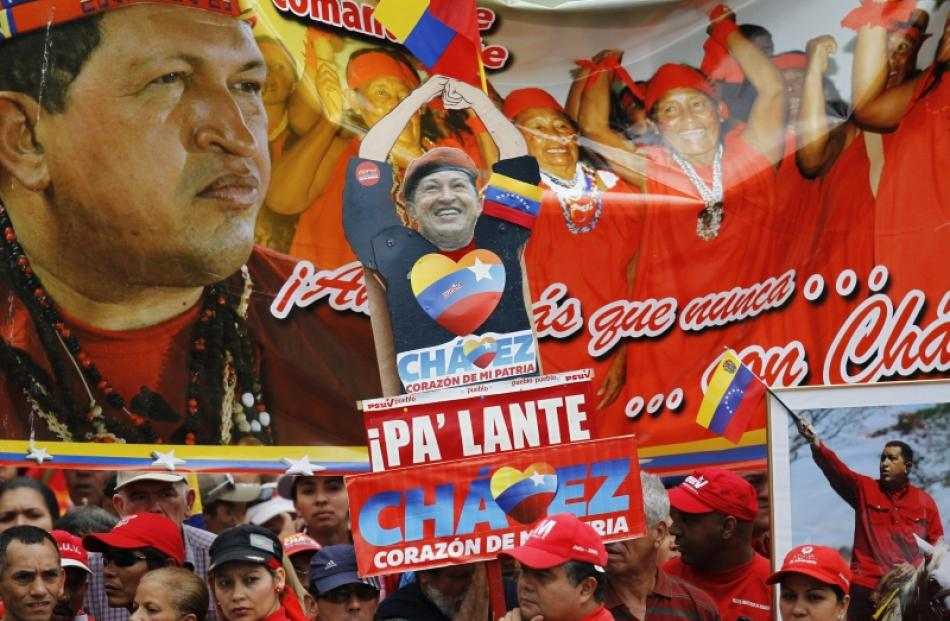Supporters of Venezuelan President Hugo Chavez attend a rally outside Miraflores Palace in...