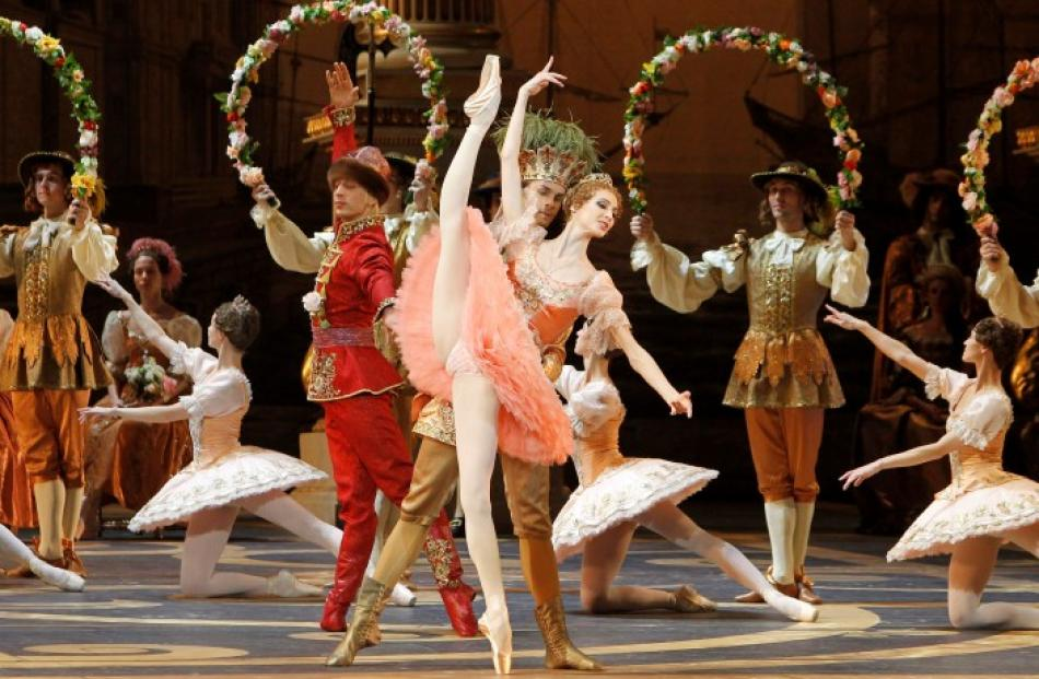 Svetlana Zakharova (C), a principal dancer of the Bolshoi Ballet, and other dancers perform...