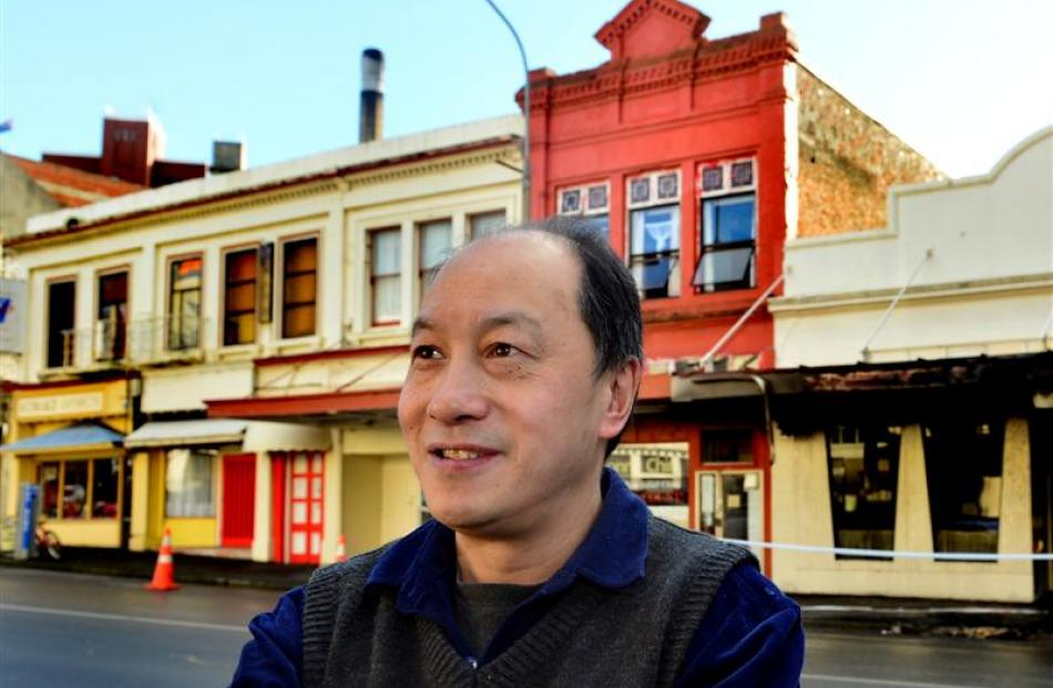 Tai Ping owner Henry Chin outside his fire-damaged restaurant yesterday. Photos by Peter McIntosh.
