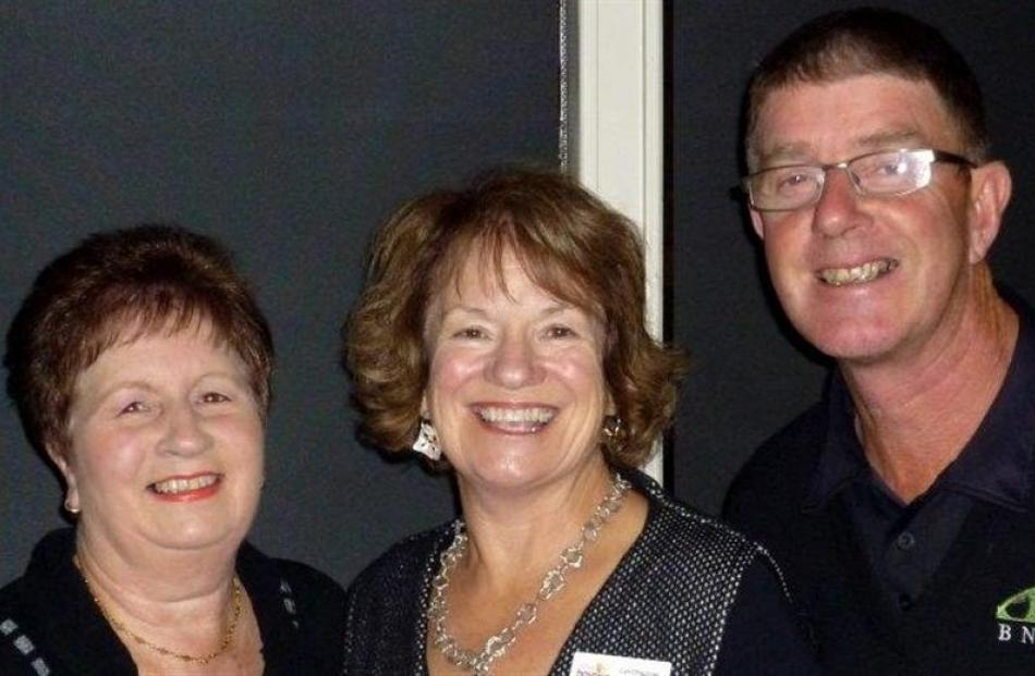 Taieri Bowling Club member Doreen Henderson (left), Otago Community Hospice funding co-ordinator...
