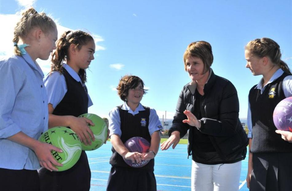 Taieri Plains Junior Netball secretary Jules Clunie (second from right) shares umpiring tips with...
