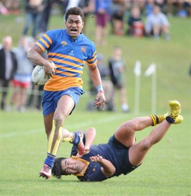 Taieri's Ben Grant charges up field  against Dunedin in the colts rugby final.  Photos by Craig...