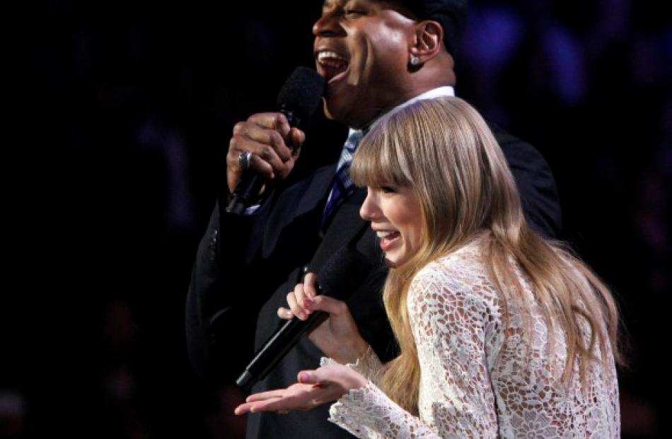 Taylor Swift (R) and LL Cool J host the Grammy Nominations Concert in Nashville, Tennessee....
