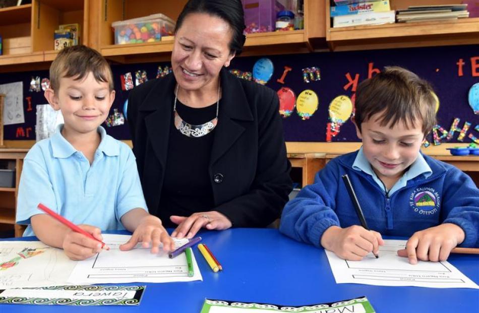 Te Kura Kaupapa Maori o Otepoti principal Tiahuia Kawe-Small works with pupils Tawera Campbell ...
