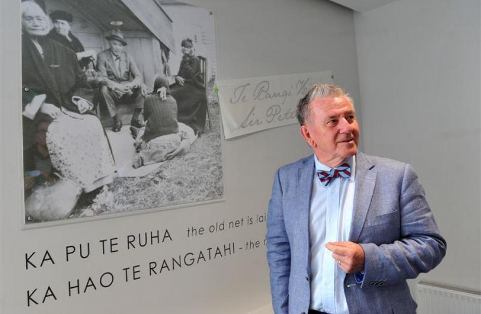 Te Rangi Hiroa College warden Ashley Day, pictured next to a photograph of Te Rangi Hiroa, also...
