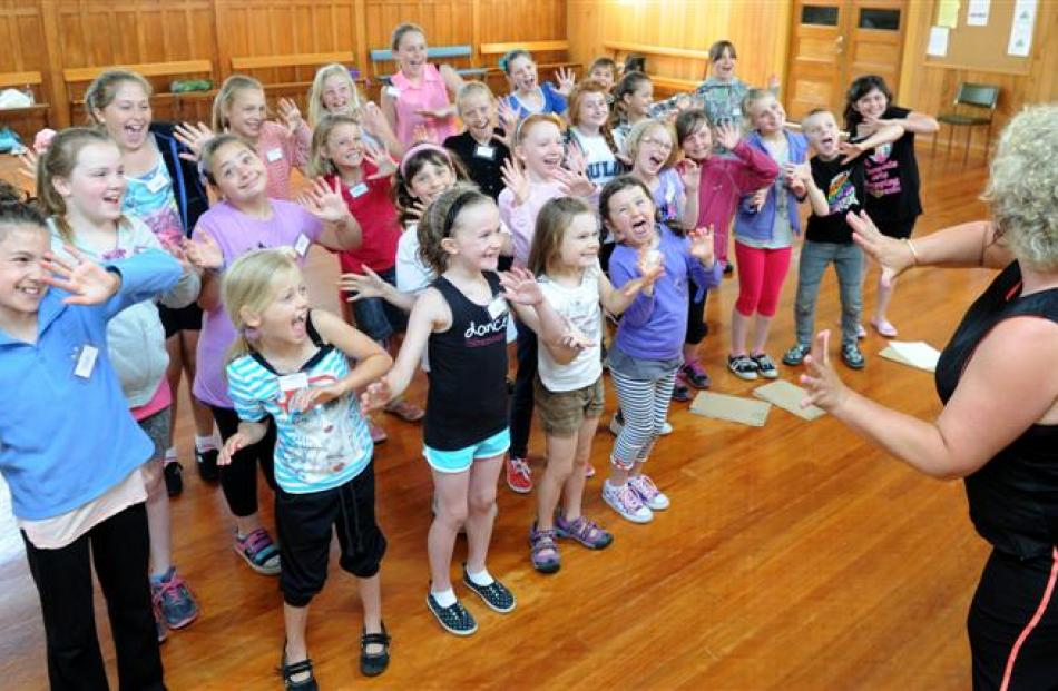 Teacher Denise Henderson leads young performers at the Musicool theatre and dance summer school...