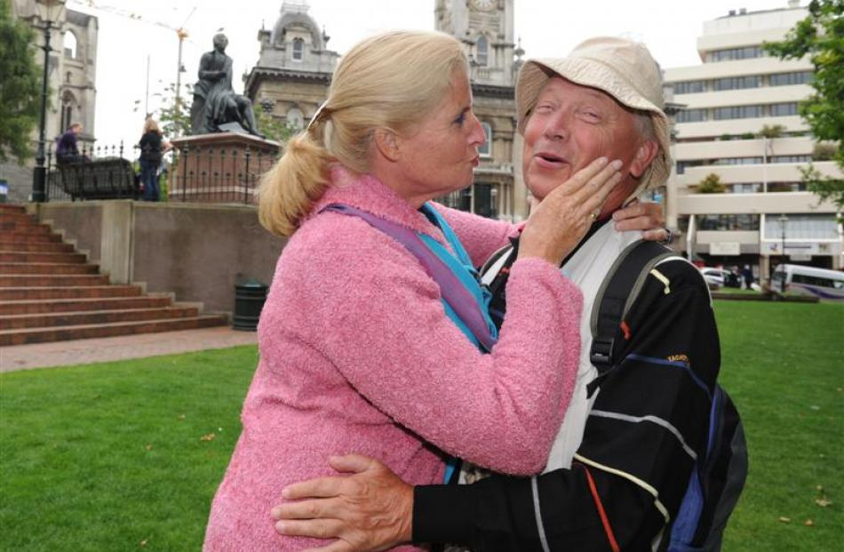 Tessa and Frans Visser, of Holland, kiss and cuddle in the Octagon yesterday during their tour of...