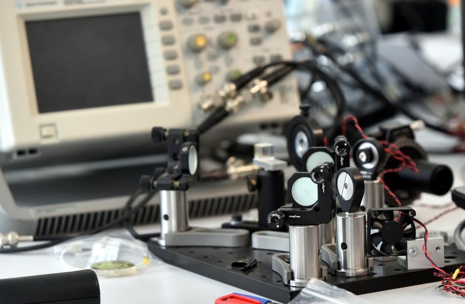 Testing mirror holders used in Phototonic's cutting-edge, laser-based technology.Photo: Peter...
