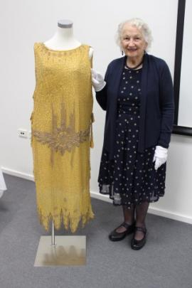Textiles historian Margery Blackman with a late 1920s dress from the Dunedin Art Gallery's...