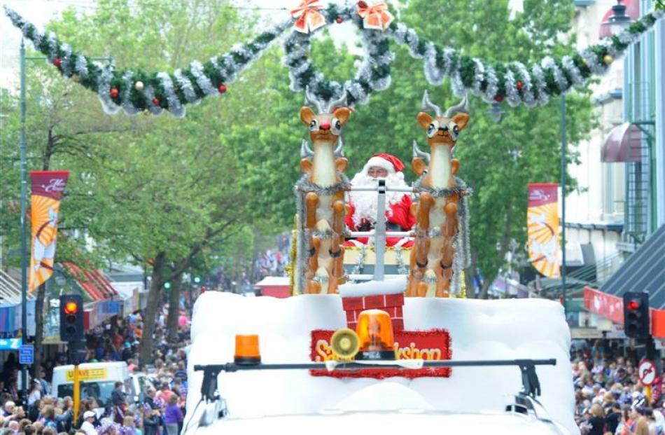 The 2012 Dunedin Santa Parade makes it way down George St. Photo by Craig Baxter.