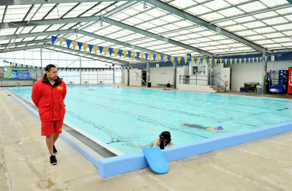 The ageing Mosgiel pool under the watchful eye of supervisor Punua Tangimetua. Photo by Linda...