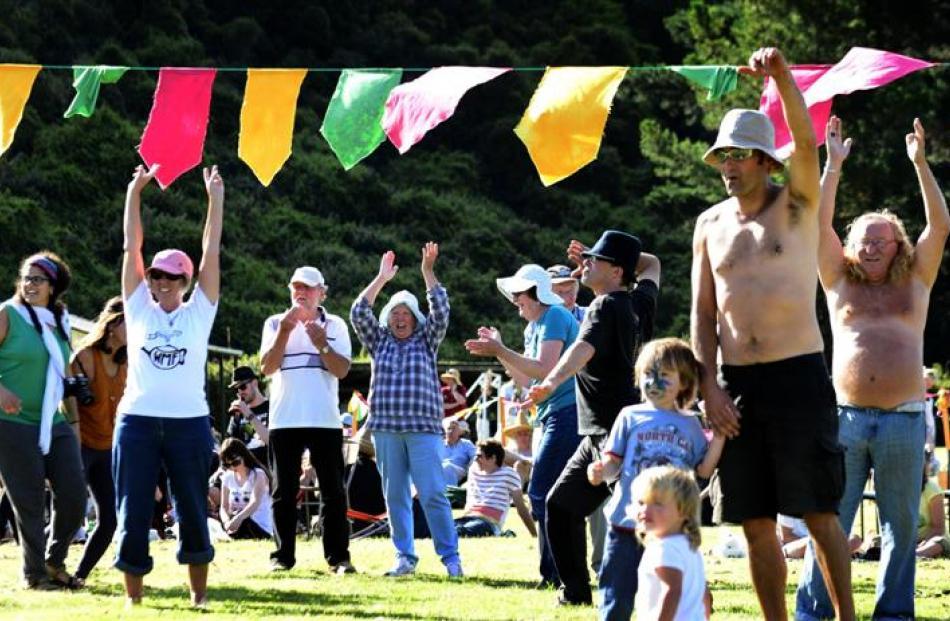 The appreciative crowd dance at the Waitati Music Festival on Saturday.