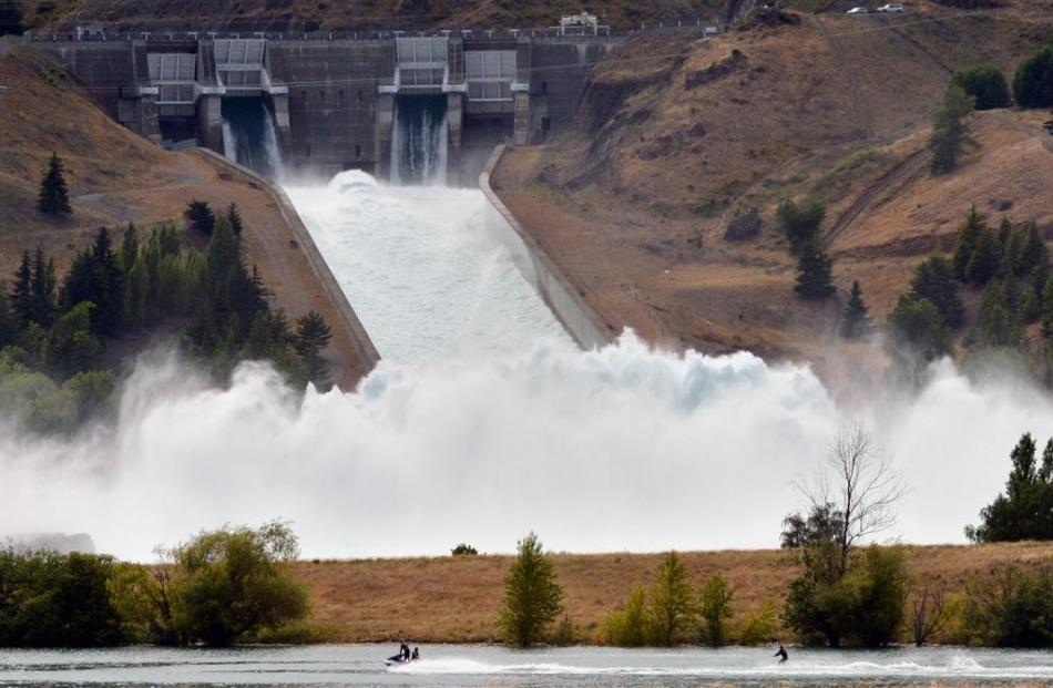 The Benmore and Clyde Dams, both spilling at full force in early 2013. PHOTOS: ODT FILES