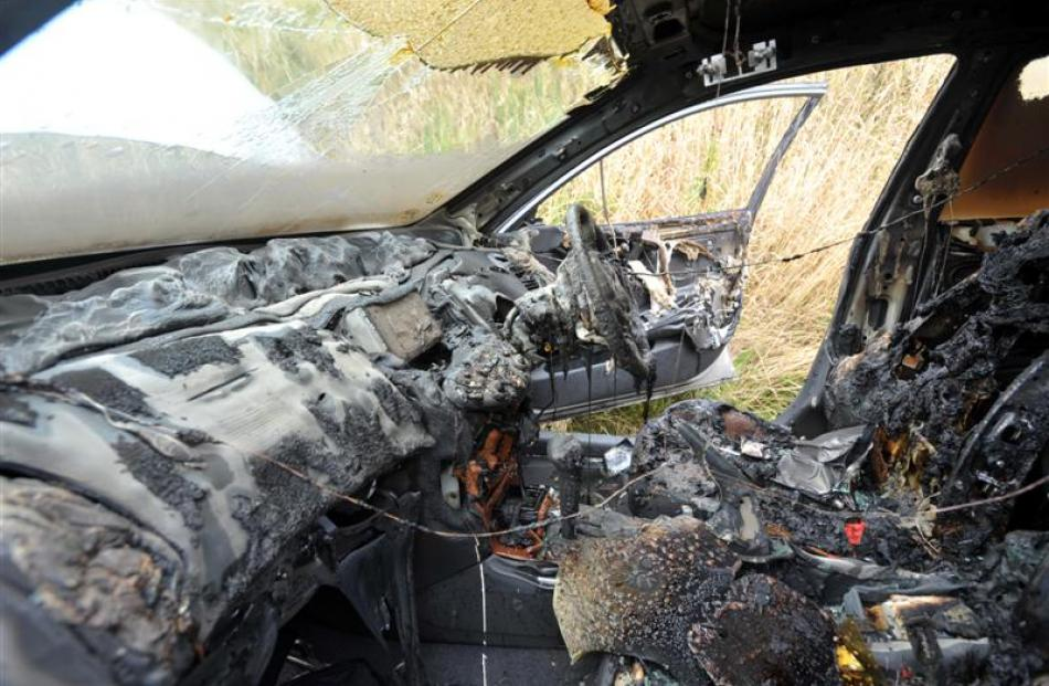 The burnt-out interior of a car in Highcliff Rd, Sandymount, yesterday afternoon. Photos by...