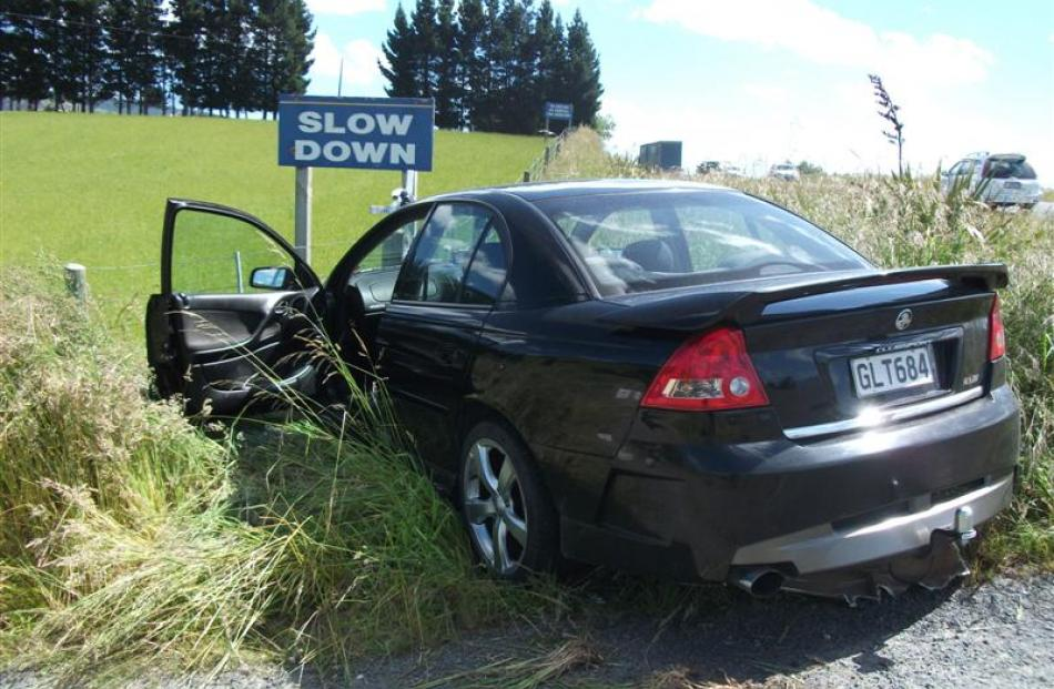 The car which hit a fence in yesterday's crash north of Waihola. Photo supplied.