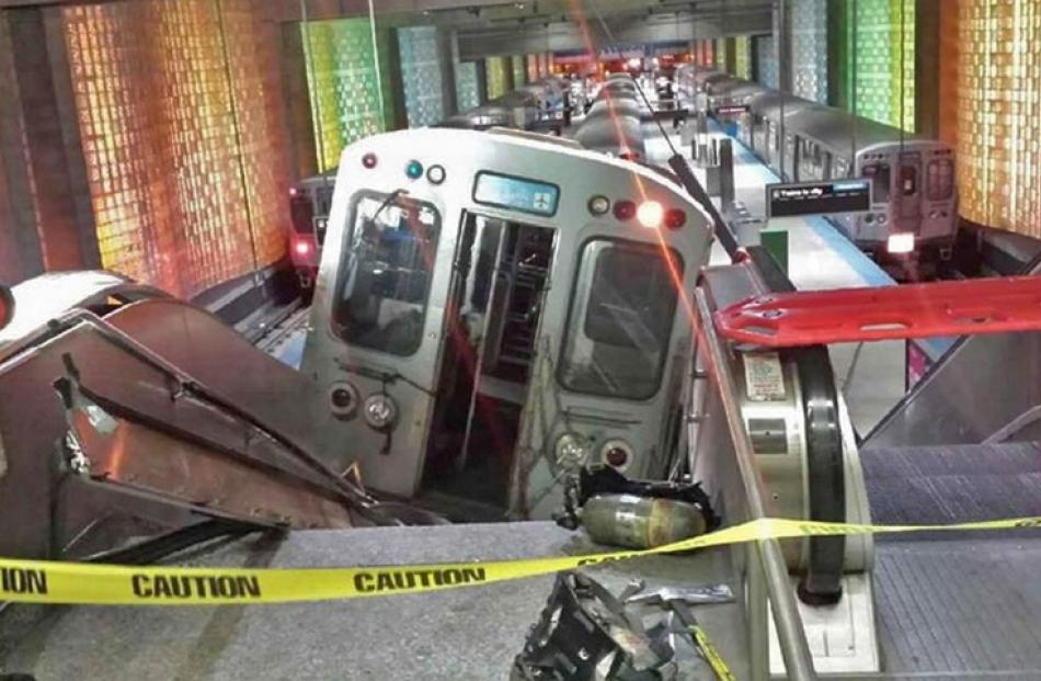 The Chicago Transit Authority train car rests on an escalator at the O'Hare Airport station after...