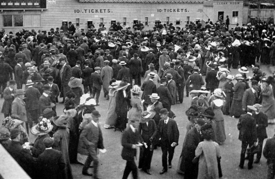 The crowd in front of the totalisator at the Forbury Park Trotting Club's autumn meeting on...