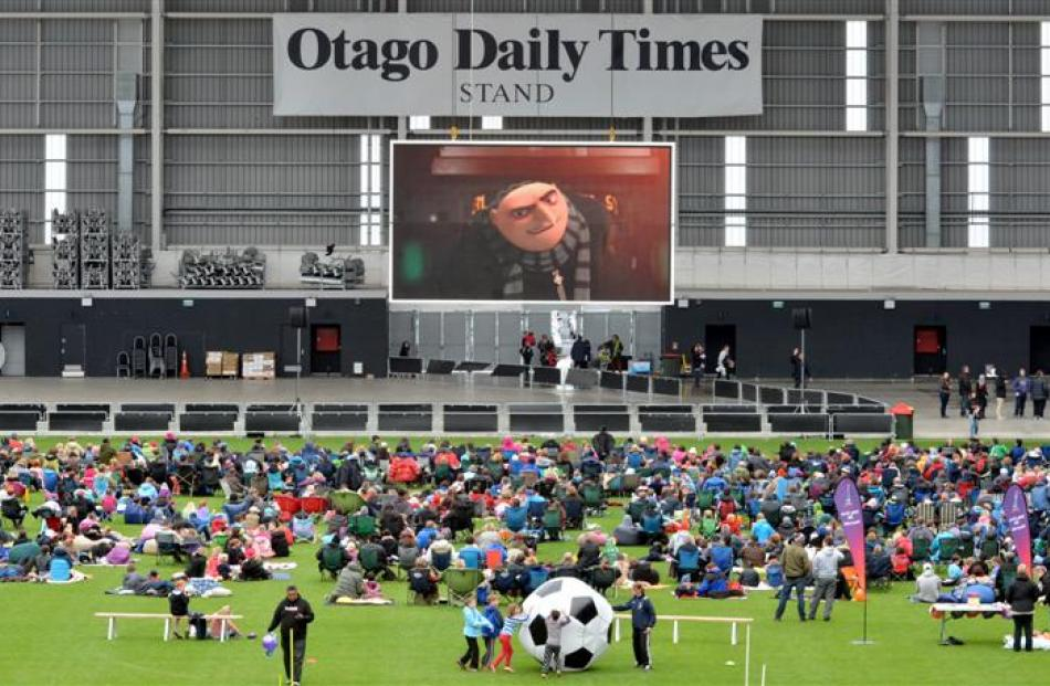 The crowd settles in as Despicable Me begins at Forsyth Barr Stadium.
