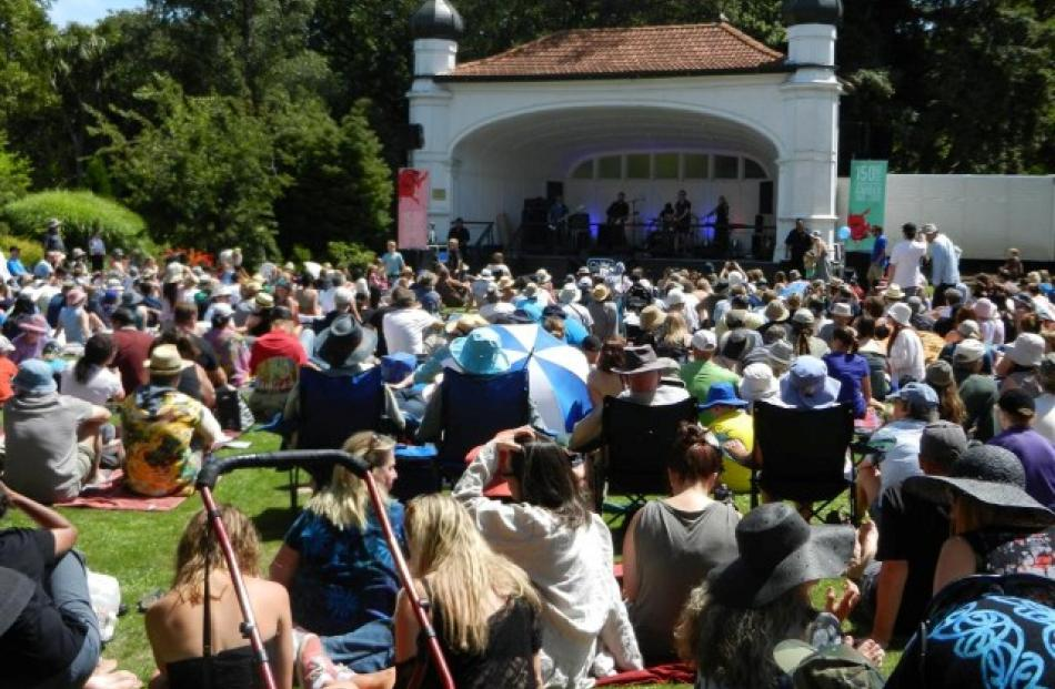 The crowd soak up the sun and the sound of Dunedin music legends the Chills in the lower Botanic...