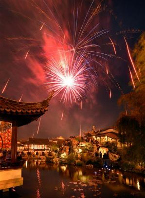 The final flurry of the night's fireworks display dazzles above the Dunedin Chinese Garden. Photo...
