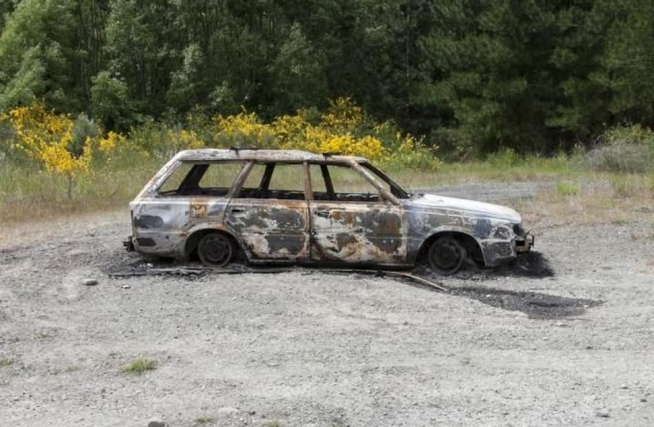 The fire-damaged Subaru station-wagon located yesterday at Dunlops Road, near Loburn. Supplied...