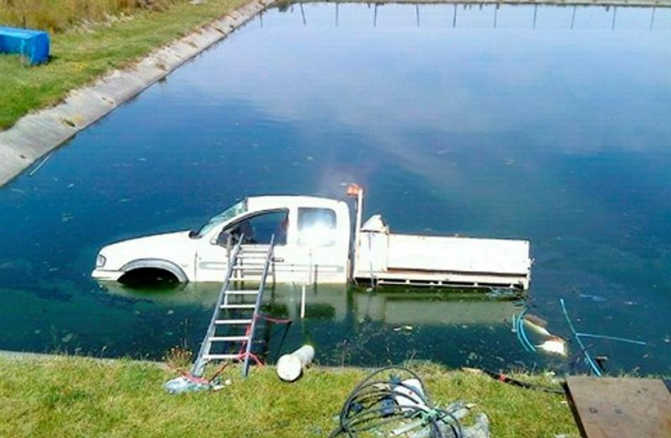 The Fulton Hogan ute was partially submerged in the oxidation pond at Heriot, West Otago, on...