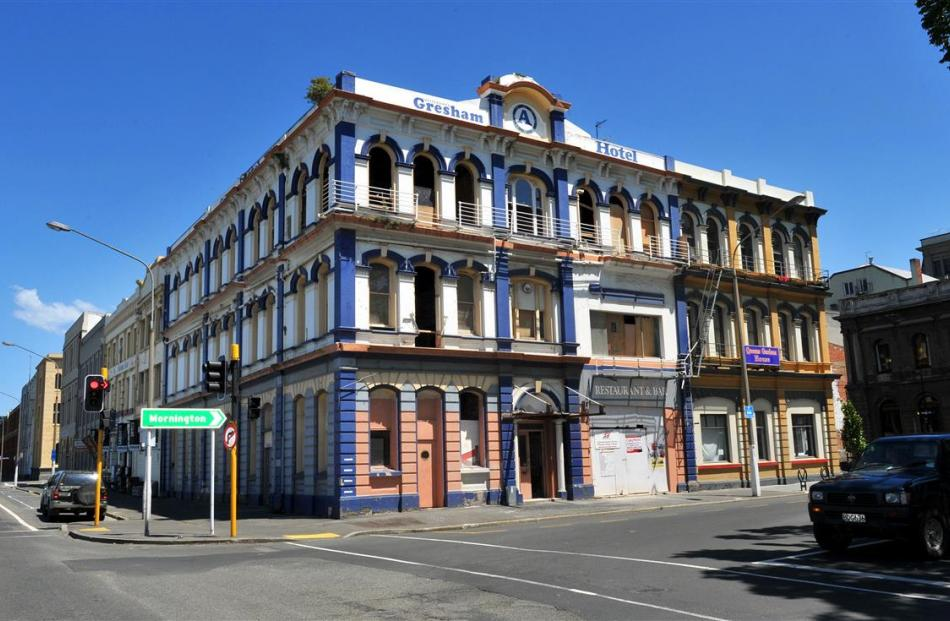 The Gresham Hotel's distinctive painted exterior will soon be replaced by the building's original...