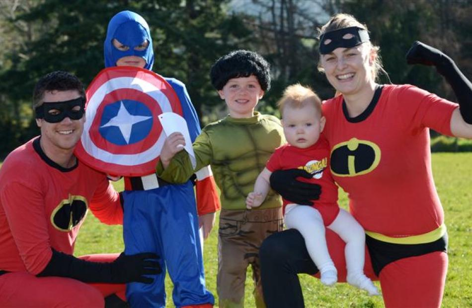 The Incredibles Mike (left) and Chloe Hawken (right) - holding 9-month-old Emerson -  were joined...