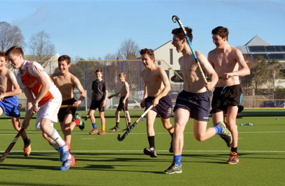The Kings High School first hockey team had a hit-around on the hockey turf playing ''skins''...