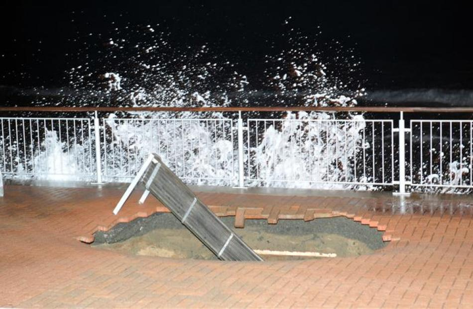 The larger hole in the  Esplanade at St Clair  at 6pm yesterday, after high tide.
